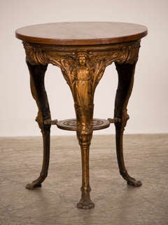 A Belle Époque cast iron table with three legs and an oak top from France c.1895