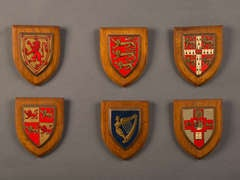 A set of oak armourial shields from a boy's preparatory school, England c.1900