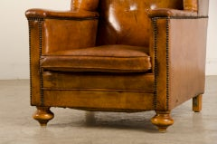 An Art Deco period leather armchair from France c. 1930 thumbnail 6