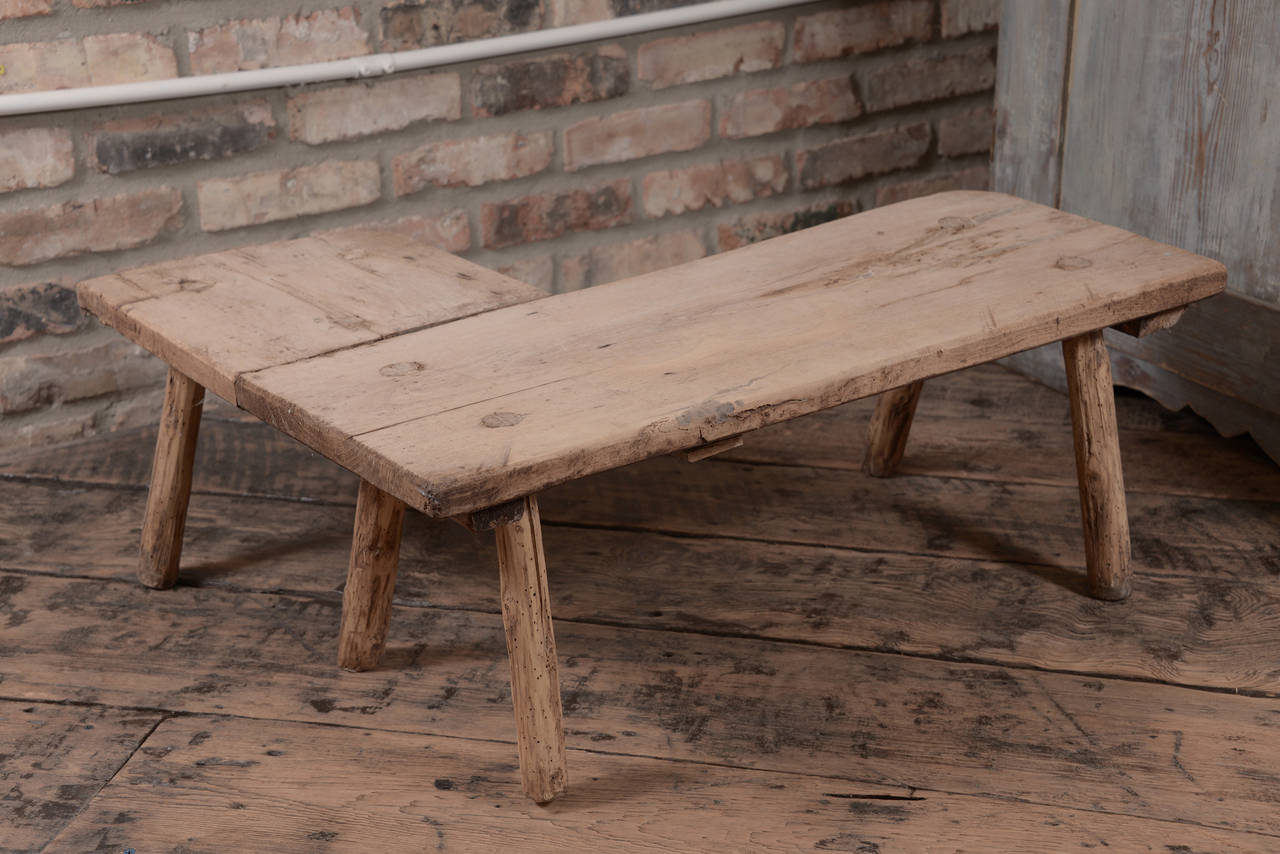 Primitive 19th century oak table from Belgium in an interesting corner shape.