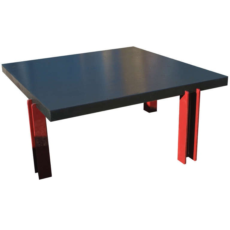 Memphis style ebonized coffee table. Wood top with steel red legs.  Measures: 36