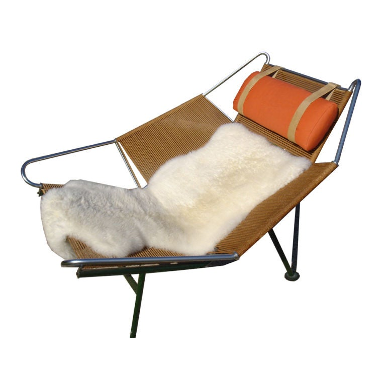 A mid century modern iconic Flag Halyard lounge chair designed by Hans Wegner.  This is a particularly fine early example with a green base made by Getama in the 1950's.  The chrome, base and rope are in especially good shape.