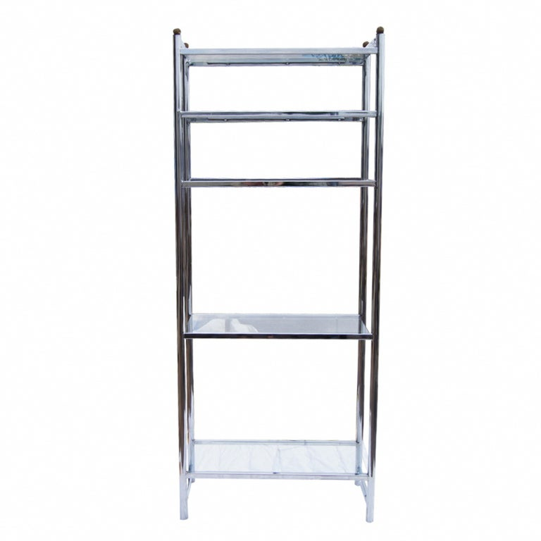 A mid century modern chrome and glass shelf unit that could be used as an etagere.