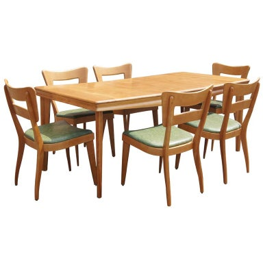 modern heywood wakefield dining table and six dogbone chairs the table