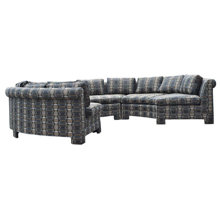 Super chic circular sectional sofa by Milo Baughman.  The sofa is in three sections.  Newly reupholstered.