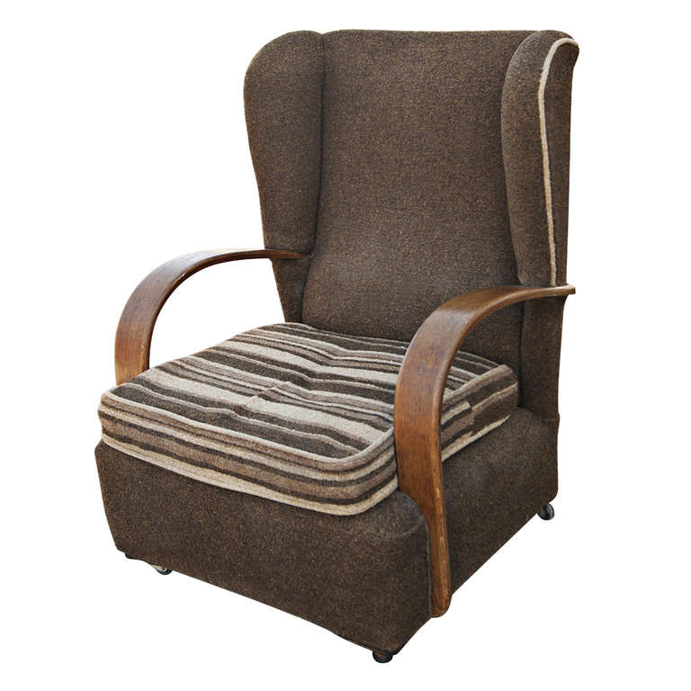 Traditional wing back chairs on casters with beautiful curved, oak arm rests.  Re-upholstery available with COM for an additional fee.