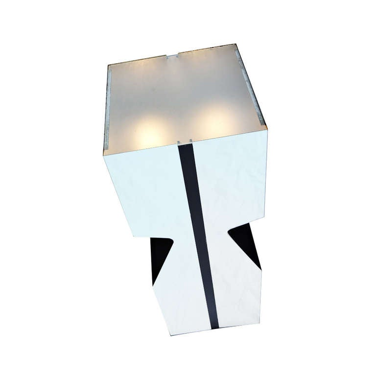 Double-pocket design and frosted glass insert.  Interior is painted flat black, matching the flat black painted stripe running down the perpendicular sides. Original push button on/off switch is present. 