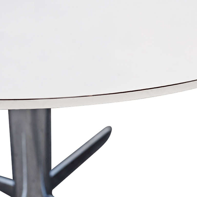 This table has a white laminate top 
