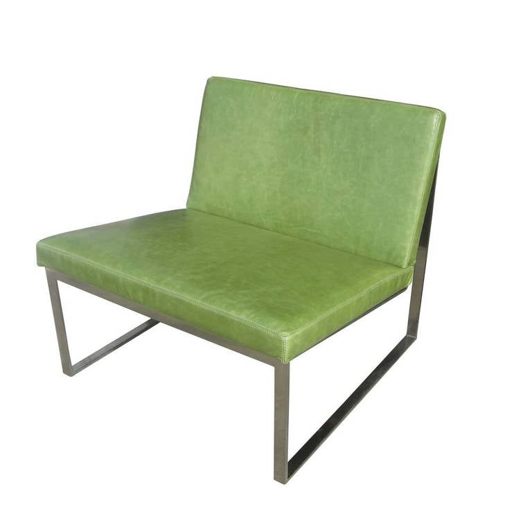A B.2 lounge chair designed by Fabien Baron for Bernhardt. B.2 lounge chair features a brushed nickel frame in textured green leather upholstery with a saddle stitch detail.