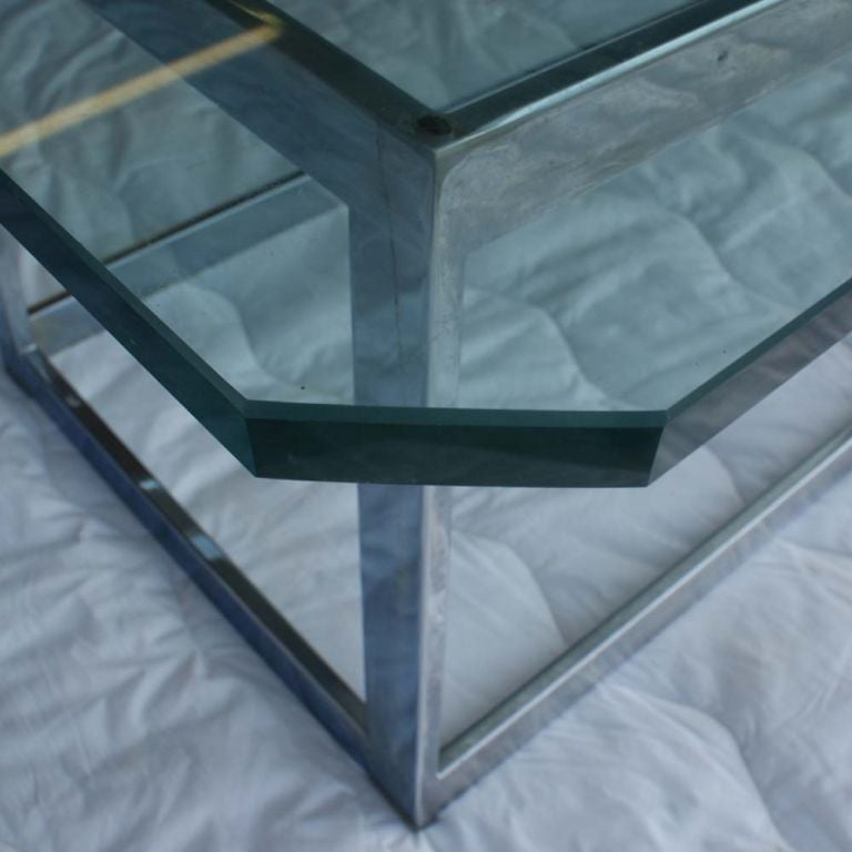 "A mid ccetury modern chrome and glass coffee table designed by Milo Baughman and made by Thayer Coggin.  The dimensions of the base are 40.5"" long, 15.75"" wide, 14.75"" high."