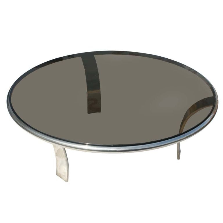 A mid century modern round coffee table designed by Gardner Leaver and made by Steelcase.  Stainless steel with a smoked glass top.  We also have a pair of matching side tables available on 1stdibs as shown in the last image.