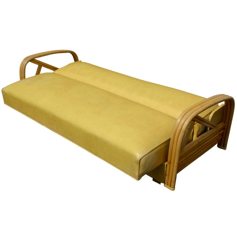 A mid century modern sofa made by Ritts Tropitan that converts into a bed in the style of Paul Frankl.  Bamboo frame with the original vinyl upholstery.  Reupholstery is available in the customer's own material at no additional cost.  We also have