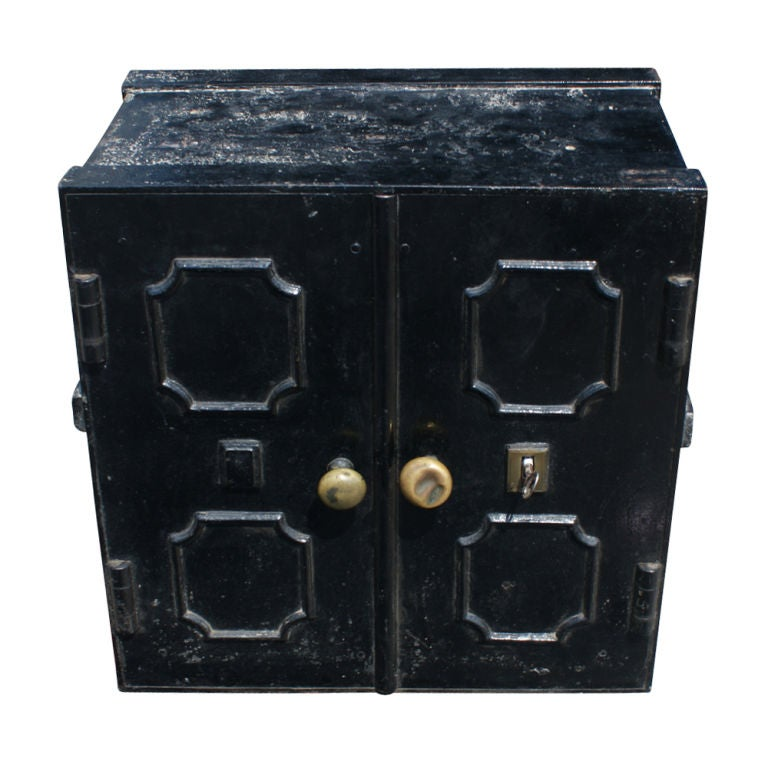 An iron safe from England made in the second half of the nineteenth century by Chubb & Son.  Double locking doors concealing shelves and two drawers.  The original key is included.