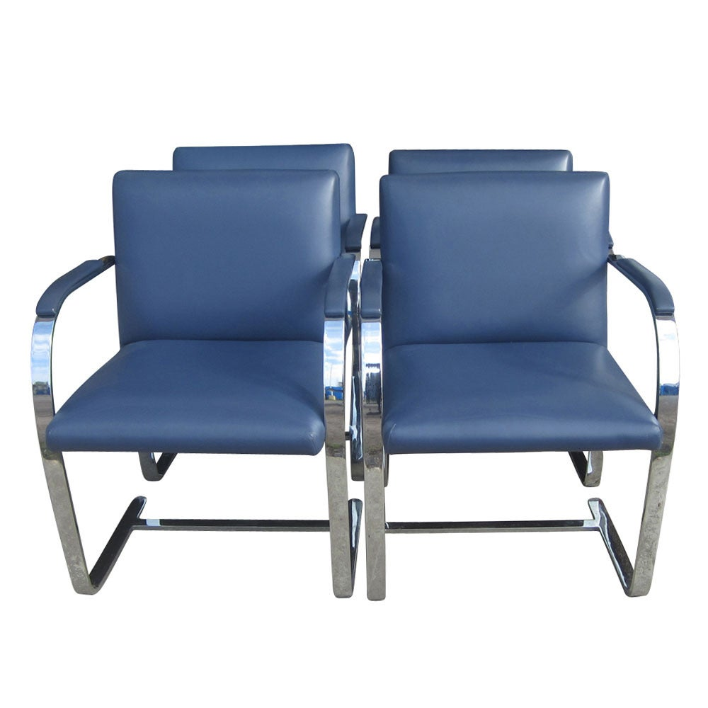 A set of four iconic pieces from the incredibly creative Bauhaus period of design, this Mies van der Rohe Flat bar Brno chair is flat bar style and upholstered in a navy leather. 