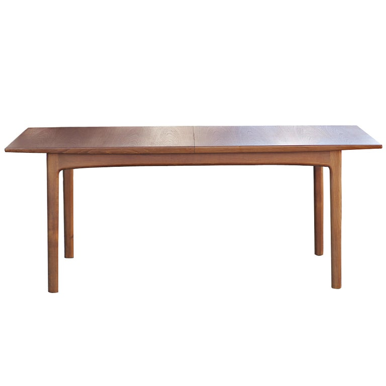 A mid century modern teak dining table designed by Folke Ohlsson and made by Dux.  The table expands from 80