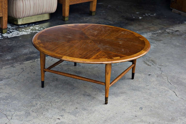 Vintage Lane Acclaim dove tailed walnut coffee table. Designed by Andre Bus this piece is great for living rooms with its Americanized Danish Mid-Century Modern aesthetic.