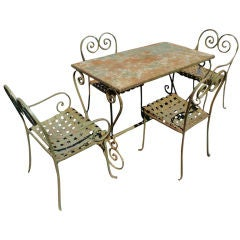 Vintage Metal Outdoor Table And Four Chairs