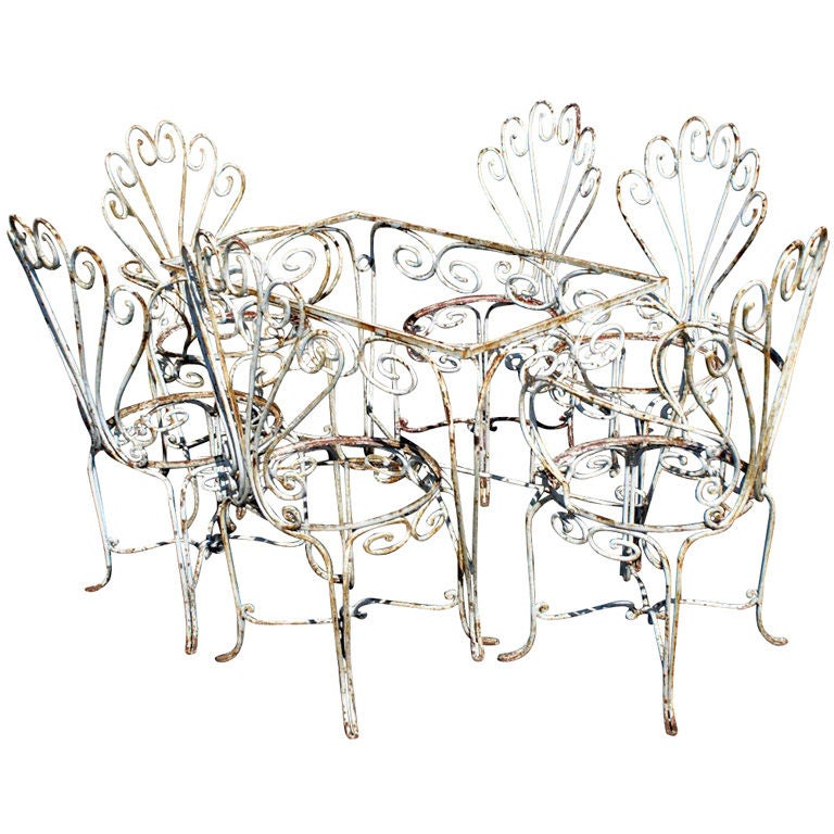 Ornate Wrought Iron Outdoor Table And Six Chairs For Sale