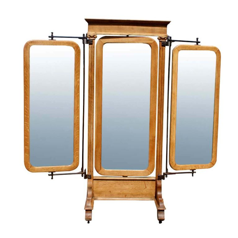 An American Empire triple floor mirror.  Three movable, rotating mirrors on iron arms mounted on an oak stand.  The stand with Ionic column detailing and casters.  A very functional as well an aesthetically appealing piece.