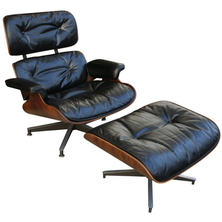Rosewood, leather with black Herman Miller/Eames label, down filled cushions, and ottoman.