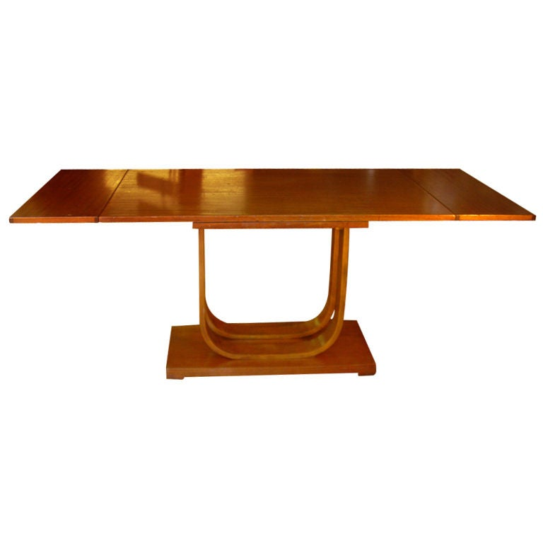 An rare Art Deco dining table designed by Gilbert Rohde and made by Heywood Wakefield.  Leaves at each end flip up to extend the table from 48