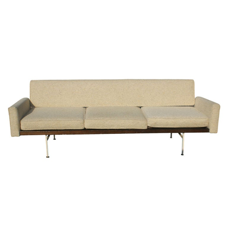 A rare mid century modern sofa designed by Ladislav Rado and made for Knoll by Drake.  Beige upholstered frame with detachable seat cushions and a steel base and legs.