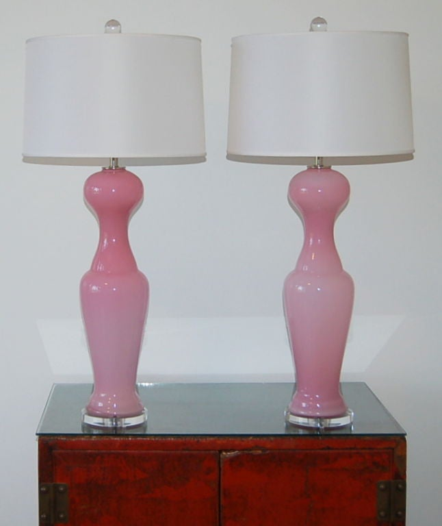 Vintage Murano interpretation of the basic black dress, in pale Chanel pink. Statuesque and curvy cased Murano glass lamps on Lucite.   These lamps measure 29 inches to the top of the socket. As shown, the top of shade is 35 inches high.