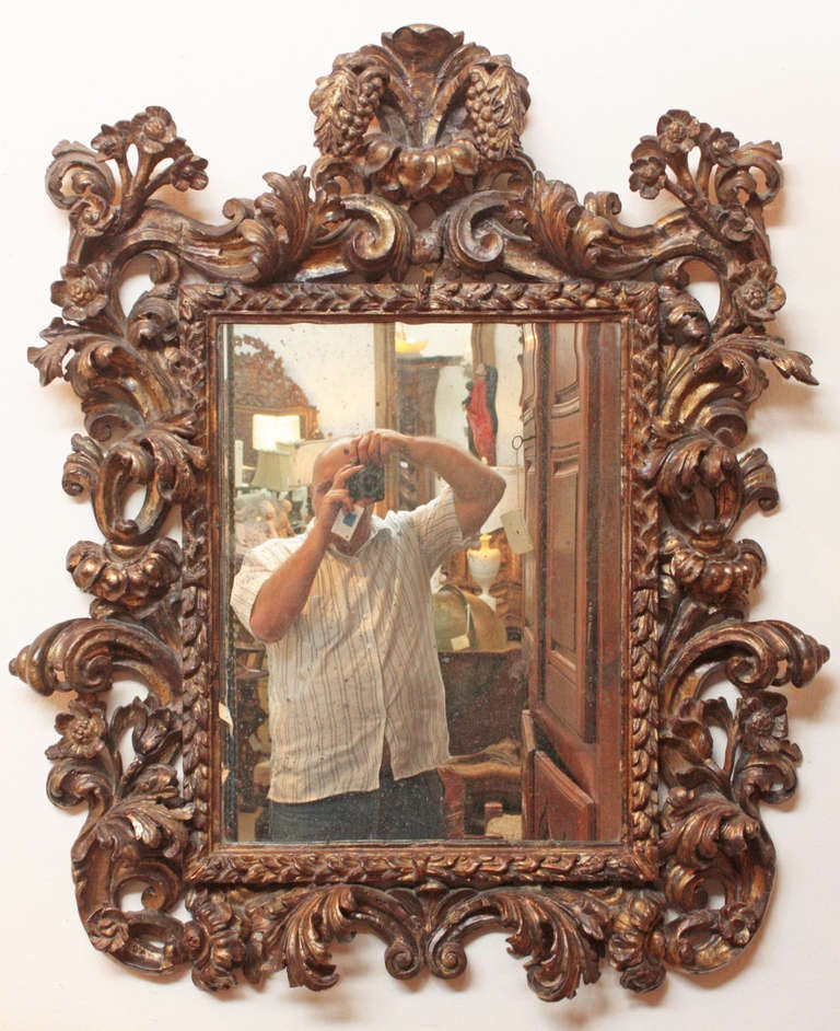 Italian baroque giltwood mirror with original plate at 1stdibs for Italian baroque mirror