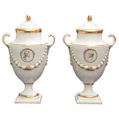 Pair of White Porcelain Lidded Urns