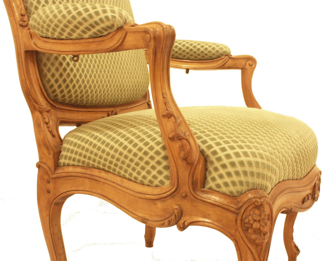 a pair of fine Louis XV style beechwood fauteuils with shaped backs featuring carved foliate designs on apron and seat back, all atop four wonderfully carved cabriole legs. Upholstered in green cut velvet in the shape of diamonds.