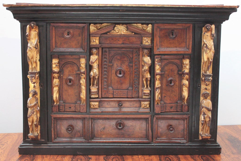 a 17th century Italian ebony and walnut Bambocci (cabinet) with giltwood figures