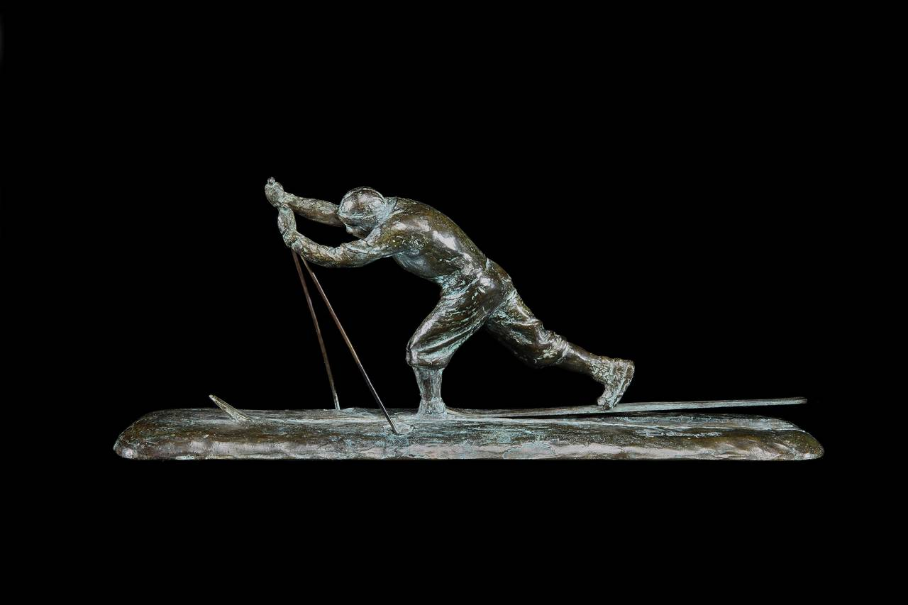 A very stylish Art Deco cire perdue (lost wax) bronze sculpture of a cross-country skier, circa 1925 with all-original patina and finish, the skier in traditional period dress is depicted forging ahead with his sticks through the snow. Set on a