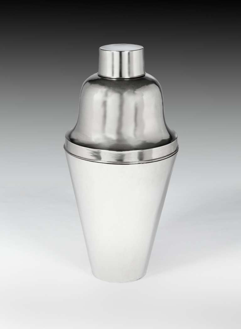 """An enormous silver plated cocktail shaker of conventional form, standing an extraordinary 28"""" (71cm), in height, probably made as an exhibition or bar display piece, and ideally suited as a Champagne chiller, able to contain 6 Champagne bottles on"""