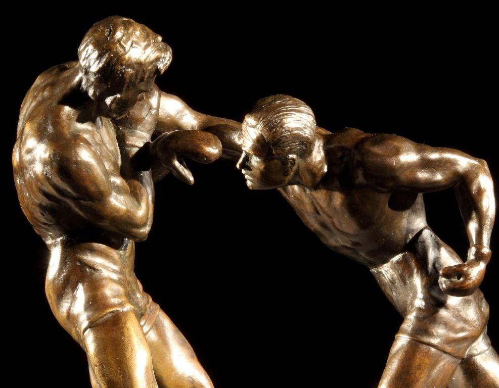 A very dynamic bronze sculpture of two sparring boxers, with a rich dark patine to the bronze, the two figures set on a bronze sôcle, bearing the sculptors signature and foundry mark for AG of Paris, dated 1924. 
