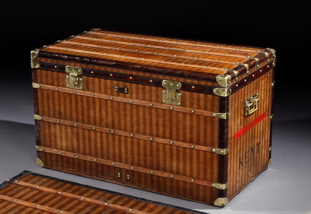 A very early 'Haute' courier trunk in Rayée (striped) canvas, with all leather trim and brass handles, flat locks and studs, the interior, canvas lined with three lift out trays, and tricolore striped ribbon detail to the interior of the lid, the