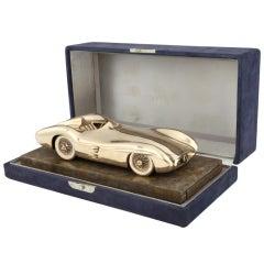A bronze sculpture of the 1955 Mercedes-Benz Type W196 'Streamliner'