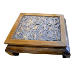 Coffee table with antique carvings of of birds and flowers.