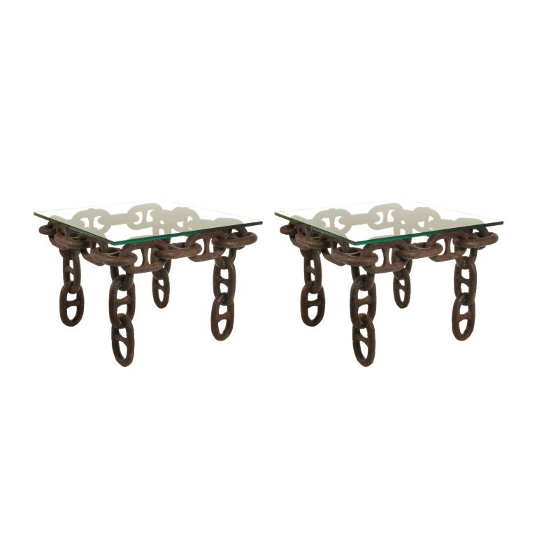 Pair of large chain link side tables with glass tops at