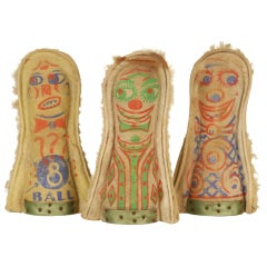 A Collection of Three Knock Down Dolls