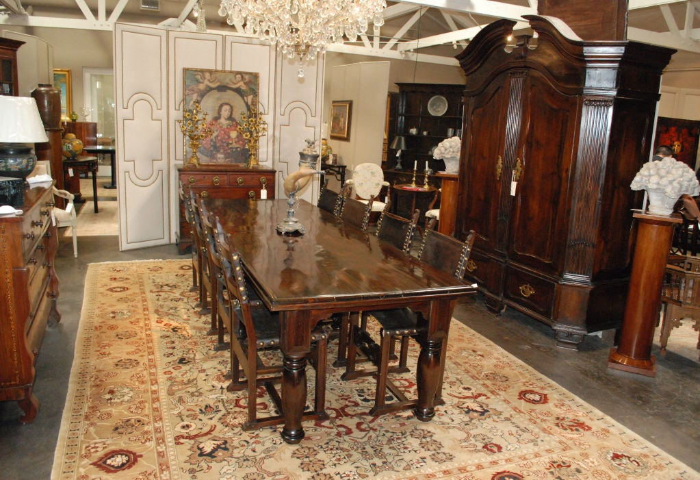 British Colonial Table Having A Multiple Plank Top And Frieze Above Four Turned Tapered