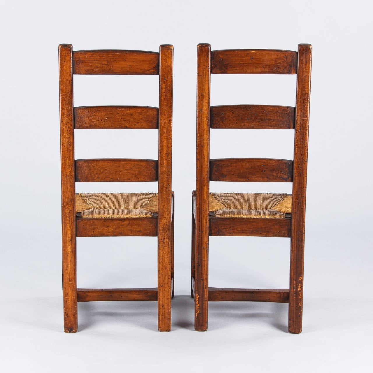 set of four country french oak chairs with rush seats