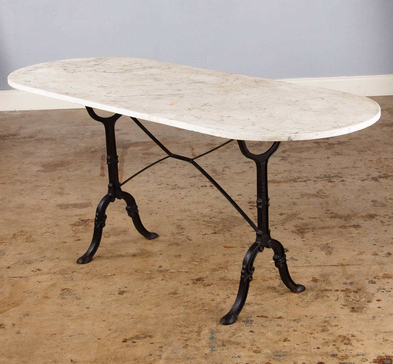 Industrial French Bistro Table With Oval White Marble Top, 1920s For Sale