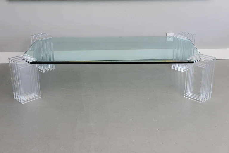 the legs with architectural form on a glass with canted corners