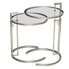 A Pair of Eileen Gray Polished Chrome and Glass Tables
