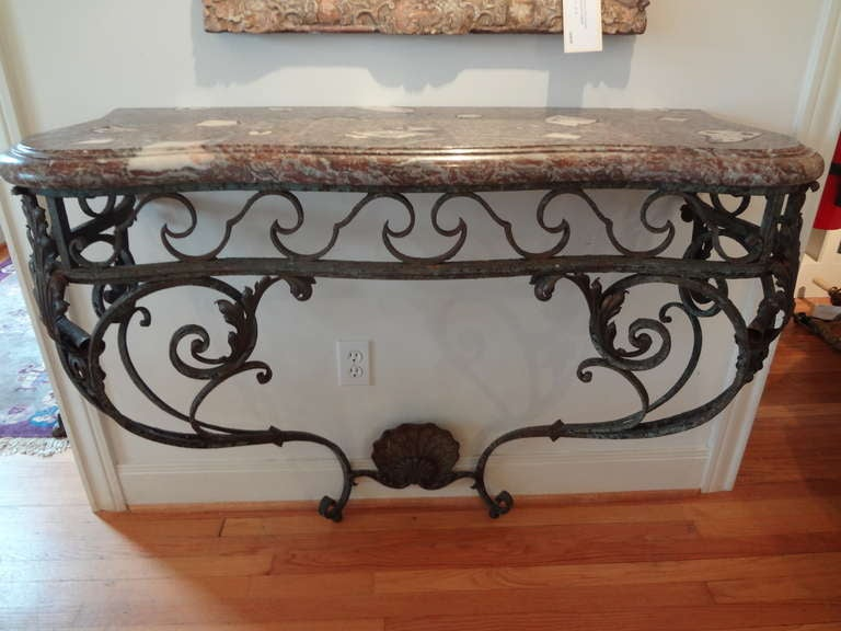 Late 18th-early 19th century French Régence hand forged wrought iron console with stunning original marble top. The wrought iron on this gorgeous French console table has a beautiful untouched desirable distressed finish.