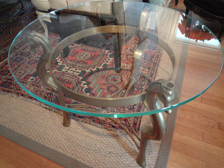 Late 20th Century Round Italian Brass Table With Seahorse Supports And Glass Top For Sale