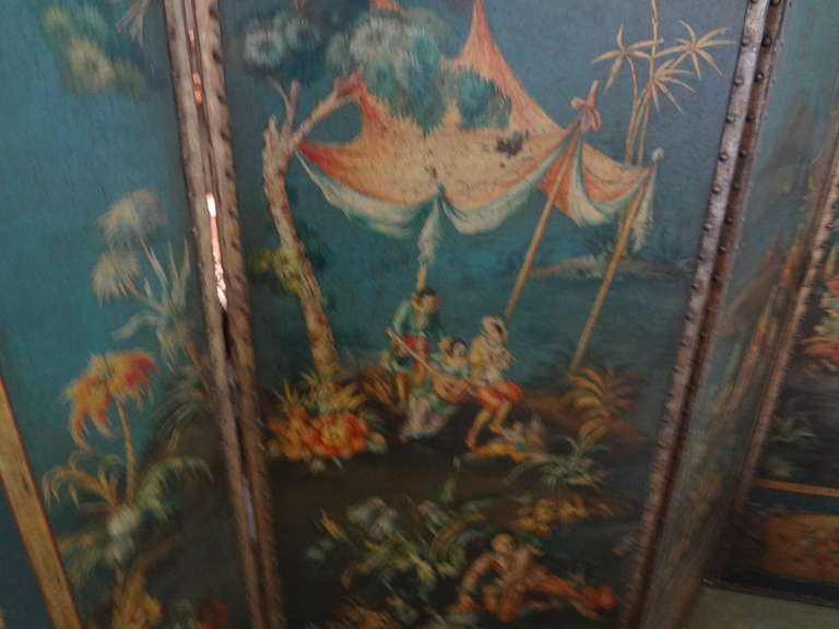 Lovely hand-painted Italian chinoiserie four-panel leather screen/room divider. Fantastic color, versatile piece. Would make a great headboard.