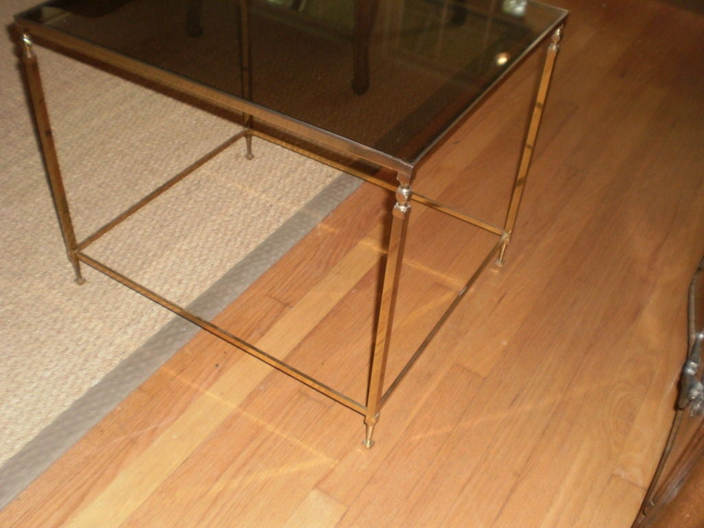 Classic French Louis XVI style brass table with smoked glass top.