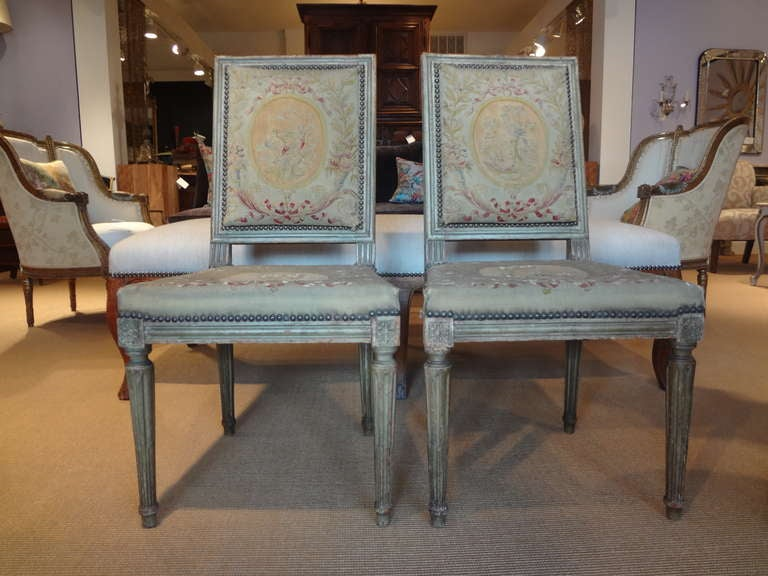 Lovely pair of French Louis XVI chairs with needlepoint upholstery from the late 18th-early 19th century.