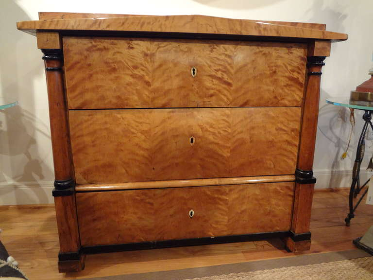 Handsome period Biedermeier three-drawer chest of drawers or commode with beautiful patina retaining the original locks and key. This outstanding antique Biedermeier commode is from the early 19th century, a true period piece.